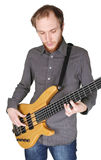 Young man with beard playing bass guitar Stock Image