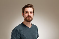 Young man with beard. Portrait of young man with beard, on neutral background Stock Image