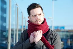 Young man with beard posing with scarf outdoors Stock Photography