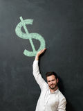 Young man with beard saving money royalty free stock images