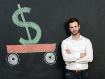 Young man with beard saving money. Concept of saving Royalty Free Stock Image