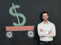 Young man with beard saving money Royalty Free Stock Image