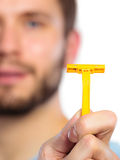 Young man with beard showing razor blade Stock Photography
