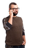 Young man with beard using cell phone Royalty Free Stock Image