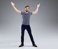 Young man with beard in victory pose Stock Images