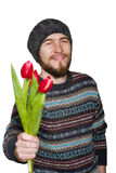 A young man with a beard wearing a sweater and hat with red tulips. Isolated on white background Royalty Free Stock Photography