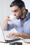 Young Man with Beard working on Laptop. Isolated on a White Background Royalty Free Stock Photos