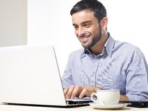 Young Man with Beard working on Laptop Stock Photos