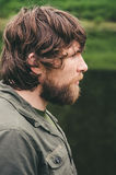 Young Man bearded curly hair portrait outdoor Lifestyle Royalty Free Stock Images