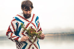 Young Man bearded with fir tree branch Fashion Travel Lifestyle Royalty Free Stock Photography