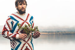 Young Man bearded with fir tree branch Fashion Travel Lifestyle Royalty Free Stock Photos