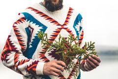 Young Man bearded with fir tree branch Fashion Travel Lifestyle Royalty Free Stock Images