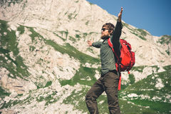 Young Man bearded hands raised hiking Travel Lifestyle concept. Mountains on background Summer journey vacations outdoor stock photos