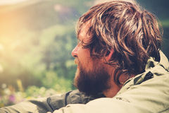 Young Man bearded relaxing alone outdoor Stock Images