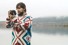Young Man bearded with retro photo camera Fashion Travel Lifestyle Stock Photos