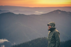 Young Man bearded standing alone outdoor. With sunset mountains on background Travel Lifestyle and survival concept royalty free stock photos