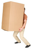 Young man bears the big box on a back Royalty Free Stock Photography