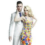 Young man and beautiful lady in flower dress royalty free stock image