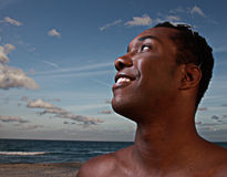 Young man on a beautiful sky Stock Image