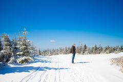 Young man in beautiful winter mountain landscape Royalty Free Stock Photos