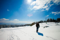 Young man in beautiful winter mountain landscape Stock Images