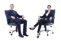 Young man and beautiful woman in business suits sitting on office chairs isolated on white. Young men and beautiful women in business suits sitting on office stock photography