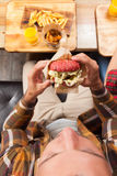 Young Man Beef Burger Top Angle View Royalty Free Stock Images