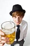 Young man with beer. Young man with a glass of beer stock photo
