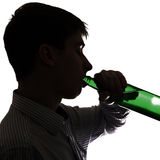 Young Man with a Beer Royalty Free Stock Photos