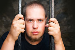 Young man behind the bars Royalty Free Stock Photography