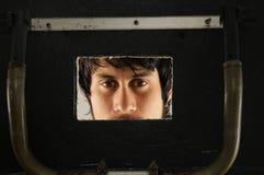 Young man behind a board Royalty Free Stock Photos