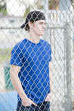 Young man behind a fence Stock Photo