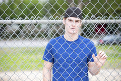 Young man behind a fence Royalty Free Stock Image