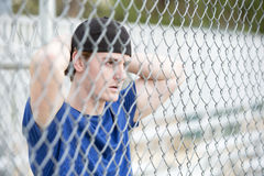Young man behind a fence Royalty Free Stock Photo