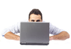 Young man behind a laptop Royalty Free Stock Image