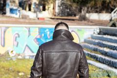 Young man from behind with leather jacket in an abandoned space royalty free stock photography