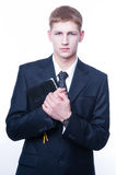 Young man with Bible Royalty Free Stock Image