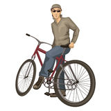 Young man on a bicycle Royalty Free Stock Photos