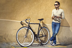 Young man with bicycle Stock Photos