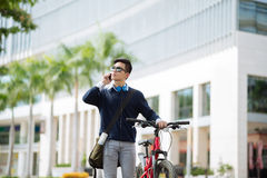 Young man with bicycle Royalty Free Stock Image