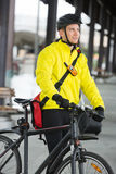 Young Man With Bicycle And Bag Looking Away Stock Photos