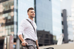 Young man with bicycle on city street Royalty Free Stock Photo