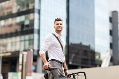 Young man with bicycle on city street Royalty Free Stock Images