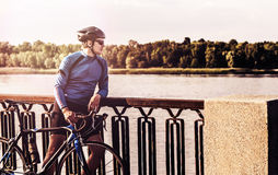 Young man with a bicycle near the river Royalty Free Stock Photo