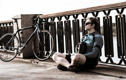 Young man with a bicycle near the river Stock Photography