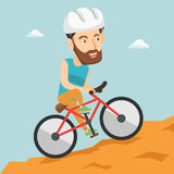 Young man on bicycle traveling in the mountains. Royalty Free Stock Photos