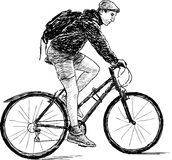 Young man on bicycle. Vector image of a young man riding a bicycle royalty free illustration