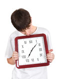 Young Man with Big Clock Royalty Free Stock Images