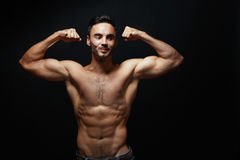 Young man with big muscles Stock Images