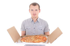 Young man with big pizza isolated on white Royalty Free Stock Photo